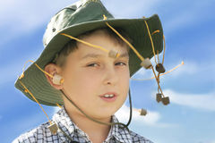 G'day mate. Aussie outback boy against a saturated sky Stock Image