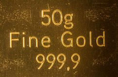 50g Fine Gold 999,9. Written on a gold bar Royalty Free Stock Photography