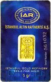 5g gold bar in blister pack. ISTANBUL - JANUARY 01, 2014: Photo of Istanbul Gold Refinery Inc. 5g gold bar in blister pack. IAR istanbul ALTIN rafinerisi is one Stock Photo