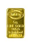 5g gold bar on white background. ISTANBUL - JANUARY 01, 2014: Photo of Istanbul Gold Refinery Inc. 5g gold bar on white background. IAR istanbul ALTIN rafinerisi Stock Image