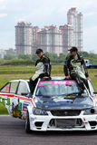 G.Hachatryan and G.Stepanyan sit on car roof Royalty Free Stock Photos