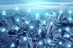 5G icons multiple exposure on the big city skyline connection technology future plan. Signal in blue tone stock photography