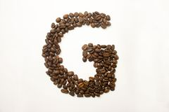 G the letter. alphabet of coffee. Coffee beans. concept of healthy eating. photo for your design. horizontal orientation of the sheet royalty free stock photo