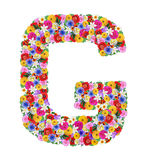 G,  letter of the alphabet in different flowers Stock Images