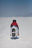 G. Lewis på hans vit och blåa toppna cykel under världen av Sp Royaltyfria Foton