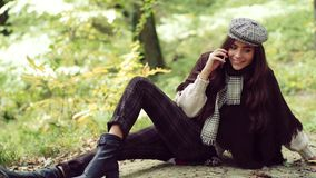 5g LTE connecting concept. Happy girl posing with phone. Cheerful beautiful girl in sweater outdoors on beautiful fall. Day. Dreamy girl with long hair in knit stock footage