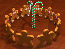 G-men theme. 3D rendering of happy little gingerbread men standing (or dancing) on the wooden floor (or table top) in circle around three candy canes. Great Royalty Free Stock Image