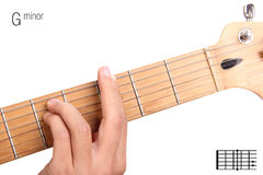 G minor guitar chord tutorial. Gm - basic minor keys guitar tutorial series. Closeup of hand playing G minor chord on guitar, isolated on white background Royalty Free Stock Photos