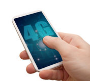 4G Mobile Internet in Smartphone. 4G Mobile Internet - Man's Hand With Smartphone With 4G Sign on Display - Isolated on White with clipping path Stock Photo