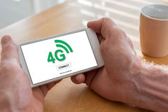 4g network concept on a smartphone. Male hands holding a smartphone with 4g network concept Royalty Free Stock Images