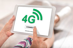 4g network concept on a tablet. Woman using a tablet with 4g network concept Royalty Free Stock Photo