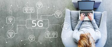 5G network with man using a laptop royalty free stock images