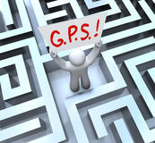 G.P.S. Global Positioning System Person Lost in Maze. The word or acronym for G.P.S. - Global Positioning System on a sign held up by a person lost in a maze or Stock Photography