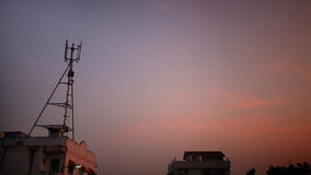 3G phone antenna against twilight sky Stock Images