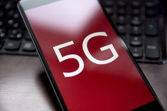 5g phone. Smartphone with high-speed Internet 5g close-up with shallow depth of field Stock Photography