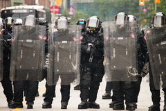 G20 Riot Police. Police form a line to block the road at a G20 Protest royalty free stock images