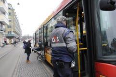 G4S TICKET CHECKER. Copenhagen / Denmark_ 19h.December 2016 - Ticket checker taking bus to check passenger without ticket . Photo. Francis Joseph Dean/ stock image
