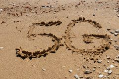 5G shape on the sand royalty free stock images