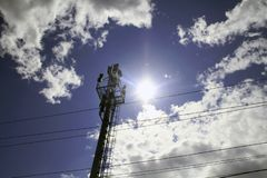 5G smart mobile telephone gsm network antenna base station on the telecommunication mast radiating signal stock image