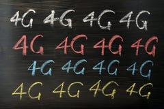 4G som är skriftlig med krita Arkivfoton