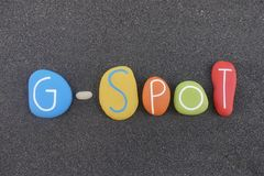 G-Spot, erogenous zone emblem text composed with multi colored stones over black volcanic sand. The G-spot, also called the Gräfenberg spot for German stock image