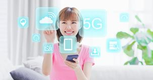 5G technology concept. Young woman hold smart phone and touch cloud computing icon with 5G technology virtual screen interface royalty free stock photo