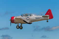 AT-6G Texan Flies By With Landing Gear Down Royalty Free Stock Photography
