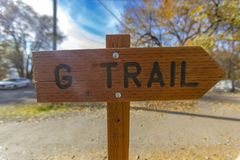 G trail sign pointing to the right trees behind stock photos