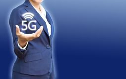 5G wireless networks in business people hand show for new connections with copy space. On blue background stock photo