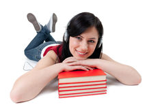 G woman in headphones with books Royalty Free Stock Photos