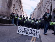 G20 Protest April 1 2009. Capitalism is Condemned. Police lined-up for the security near the Bank of England on the April 1st 2009