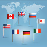 G8  flag pins over world map silhouette. Glossy  beautiful pin flags of Canada, Germany, Russia, UK, Italy, France, USA and Japan hanging in round over light Royalty Free Stock Photography