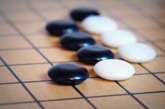 Ga de speelstukken van het raadsspel royalty-vrije stock afbeeldingen
