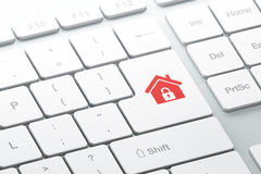 Ga knoop met huis op computertoetsenbord in Stock Afbeelding