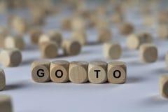 Ga - kubus met brieven, teken met houten kubussen stock foto's
