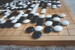 Ga of Weiqi-raadsspel royalty-vrije stock afbeeldingen