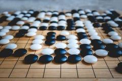 Ga of Weiqi-raadsspel royalty-vrije stock afbeelding