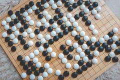 Ga of Weiqi-raadsspel stock afbeeldingen