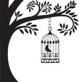 Gabbia ed albero di uccello Immagini Stock Libere da Diritti