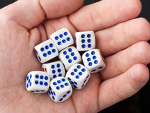 Gabbling dices in palm of hand Royalty Free Stock Photography