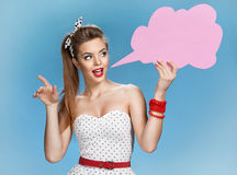 Gabby woman showing sign speech bubble banner looking happy excited Royalty Free Stock Photography