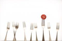 Gabeln u. Tomate Stockfoto