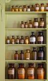 Gabinete velho do apothecary com frascos do armazenamento fotografia de stock royalty free