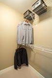 Gabinetto moderno del guardaroba con i vestiti Immagini Stock Libere da Diritti
