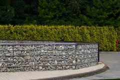 Gabion. Arrangement of space made with the help of a fence made Stock Photos