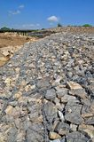 Gabion on the bank of the river stock photos