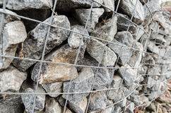 Gabion boxes protecting a river from erosion Stock Images