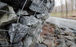Gabion boxes protecting a river from erosion Stock Photo