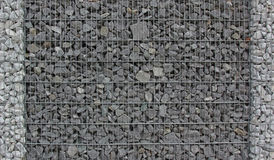 Gabion fence filled with granite stones Royalty Free Stock Photos