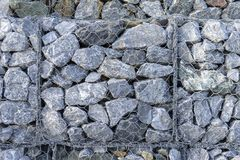 Gabion fences, Stone wall. Texture of gabion fences, wire mesh fence royalty free stock images